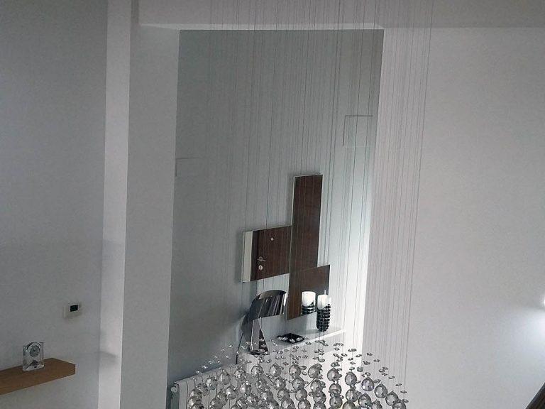 Proyecto 27334 desarrollado por CASANOVA en Sueca (Valencia): composición de salón, lámpara y recibidor.